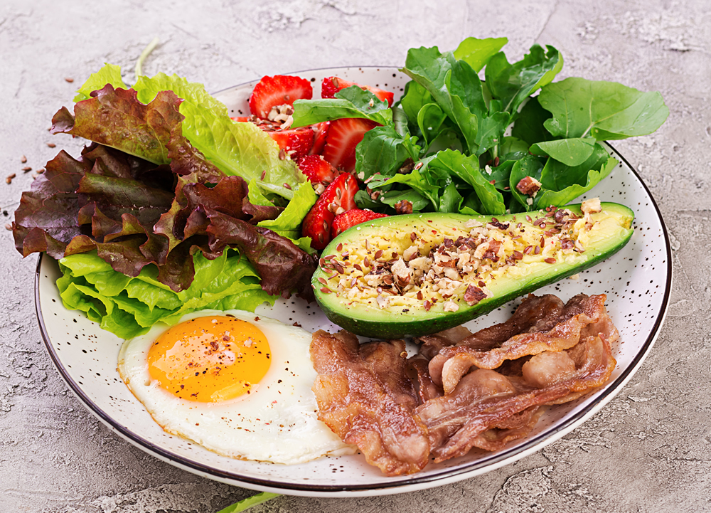 plate-with-a-keto-diet-food-fried-egg-bacon-QAHDGCL